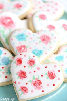 Valentine\'s Day Sugar Cookies - classic sugar cookies decorated with royal icing in a variety of gorgeous Valentine's Day designs | From SugarHero.com