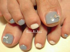 Simple grey and white with rhinestone bow toe nail art pedi