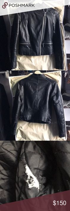 Michael Kora cropped Moto leather jacket Comes with dust bag. Leather is in great condition. Lining has a tear in the left armpit. If I was handier I'd be able to see it. Zippers at wrists. Buckles in waist. Small zippered pockets at waist. Super cute and perfect for winter night outs.  Shell: 100% real lamb leather from China Lining: 100% acetate Michael Kors Jackets & Coats