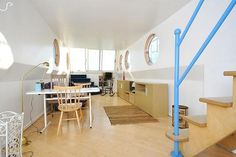 Loving the portholes in this Chelsea houseboat!