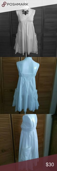 GORGEOUS SPRING/SUMMER Beautiful white spring /summer dress with big pockets on each side. Size small. 100% cotton. Never worn without tags. Gea If Dresses Mini