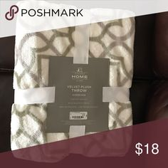 New Throw blanket Brand new pretty throw blanket. It's ivory/cream and the design is gray with the tiniest hint of green. It's 50in x 70in. Other