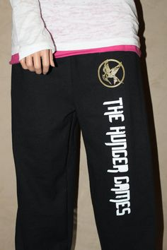 Hunger Games Inspired Gold Mockingjay Sweatpants. My two favorite things: hunger games and sweatpants