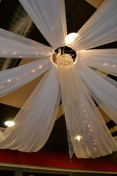 Beautiful draping for a reception ceiling.  the chandelier is awesome. Using…