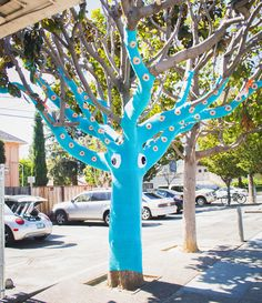 This tentacular piece of yarnbombing is the collaborative work of Jill Watt, who blogs as the Dapper Toad, and her sister Lorna of Knits For Life. This isn't their first knitted creation, but it is their biggest yet.  The sisters used four miles of yarn to transform a Magnolia tree in San Mateo, CA into a giant blue squid. They even included some crocheted goldfish trapped in the squid's tentacles.