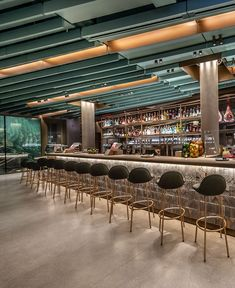 Patented SoundPly acoustic technology controls the noise in Chicago's Starbucks Reserve Roastery through gorgeous, real wood Alta acoustic ceiling panels.