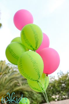 Transform plain green balloons into watermelon balloons for your summer party with only a Sharpie.