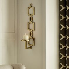 The Sadie gold wall sconce adds a traditional, decorative link pattern to the romance of candlelight. Wall, Gold Wall Sconce, Gold Walls, Wall Candle Holders Living Room, Candle Wall Sconces Living Room, Sconce Decor, Wall Sconces Living Room, Candle Wall Decor, Candle Sconces Living Room