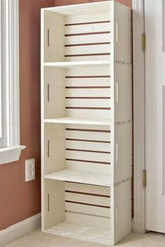 Wooden storage crates, turn this on it's side and make into seat with padded cushions on the top.