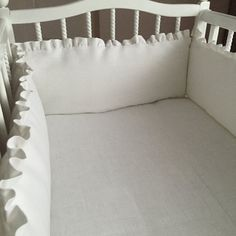Snow white crib bumper with bows and ruffles from by Madalii