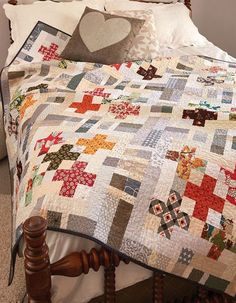"Neutral background prints make the plus signs pop in this modern throw quilt pattern. The combination of colors and prints in this project are spectacular! Precut 2½""-wide strips narrow down the prep time for Five by Five and making piecing a blast. Grab your precuts and get started!"