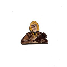 "Harness the power of the Black Lodge with this Log Lady pin. 1.75"" across, with two posts and rubber backings, this bombshell soft enamel pin will remind you that the owls are not what they seem."