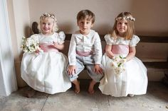 Flower girls and page boy in ivory silk dresses and pink sashes and cummerbunds - all by Amelia Brennan
