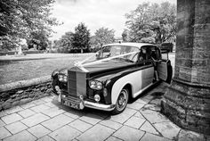 Rolls Royce wedding car at Romsey Abbey wedding by one thousand words wedding photographers in Dorset and Hampshire www.onethousandwords.co.uk