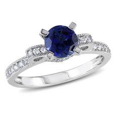 10k White Gold Round I2-I3 Diamond & Created Blue Sapphire Ring, 1/4 ctw