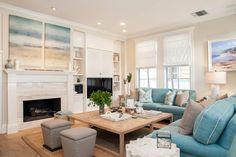 coastal family room with turquoise sofas