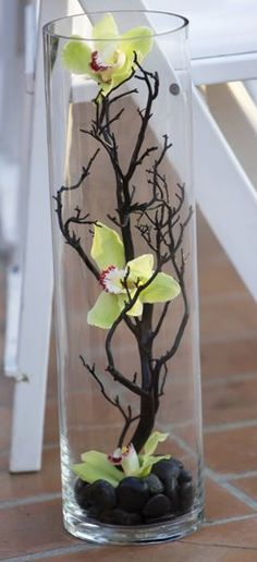 Manzanita branch and orchids contained in a hurricane...love this idea on a larger scale...and leaving the manzanitas natural sandblasted or spraying them silver or white.