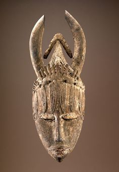 Africa | Urhobo peoples, Nigeria | Early to mid-20th century | Wood, pigment, encrustation