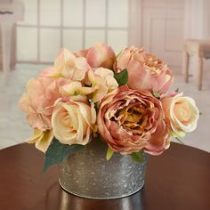 A beautifully hand crafted designer bouquet created of soft rose colors.  Created with roses, hydrangeas and peonies set in a farmhouse style metal planter.  Great design for gifts.  Perfect size for RVs, side tables and baths. 9'' H x 8'' W x 8'' D