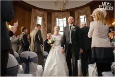 Bride and groom walk back up aisle at Cedar Court Grand Hotel Wedding.    Tux & Tales Photography