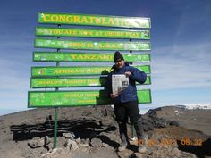 Day 7 - Alt 19,340' MSL at the summit of Kilimanjaro with the Southeast Outlook! :D