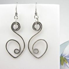 These earrings are reminiscent of Swans. Stacie needs these! Sterling Wirework Earrings HandForged Hammered by OzmayDesigns, $38.00