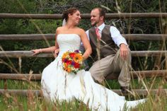 A longing gaze from the bride and groom. Look at the vibrant bridal bouquet from Boulder Blooms.