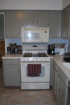 Bisque Appliances With White Cabinets Kitchen