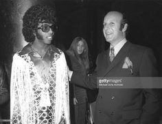 Musician Sly Stone of the psychedelic soul group 'Sly And The Family Stone' poses for a portrait with record executive Clive Davis in 1970.
