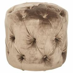 "Birch-framed ottoman with tufted mink brown upholstery.  Product: OttomanConstruction Material: Birch wood and fabricColor: Mink brownDimensions: 15.7"" H x 16"" Diameter"