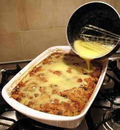Pouring topping over Amaretto bread pudding
