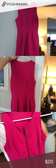 Pink Zip Up Dress Pink dress that zips up the front. I honestly think it can be worn either way. I cut off the tag so I could wear the back in the front, so I don't know what the brand is. Doesn't fit me anymore. Bought at a boutique. Dresses