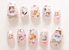 Searching for Japanese nail art? We ship worldwide!    Pastel pink translucent base,  3D blingy bows,  Cats designs,  Rhinestones,  Half pearls,  Clear