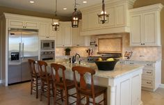 Antique white cabinets with beige countertops