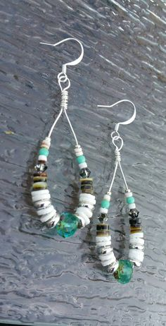 Check out this item in my Etsy shop https://www.etsy.com/listing/241518001/heishi-bead-earrings-aquamarine-picasso