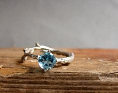 Hey, I found this really awesome Etsy listing at https://www.etsy.com/listing/183773561/swiss-blue-topaz-twig-ring-alternative