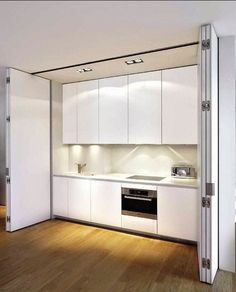Disappearing Act: 14 Minimalist Hidden Kitchens – Remodelista boffi-white-kitchen-concealed Hidden Kitchen, Kitchen Pantry, Kitchen Decor, Kitchen Ideas, Closed Kitchen, Nice Kitchen, Kitchen White, Kitchen Cabinets, Small Apartments