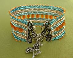 wonderful clasp - this site shows lots of interesting bracelets.  This one (I believe) shows how to make it.  Scroll to the left to see how.