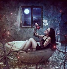 Beautiful woman sitting in a tub