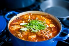 Another Kimchi jjigae recipe. Kimchi jjigae is a Korean dish made from 'Kimchi' or pickled spicy cabbage. The dish contains Kimchi, mushrooms, pork, tofu, green onions, and other various vegetables.