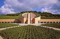 Petra Winery, Toscana region, Italy. Cylindrical core with plant-topped roof. Architect Mario Botto.