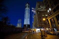 """""""One World Trade Center is illumated in the early morning hours as the building reaches 100 stories and rose higher than the Empire State Building."""" - MSNBC Photo Blog"""