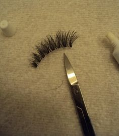 Where the tip of the scissors is -- is where I snip to cut the excess lashes away.