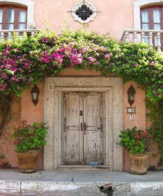 pink wall & white door and bougainvilleas, beautiful arch.. Bucerias, Nayarit Mexico