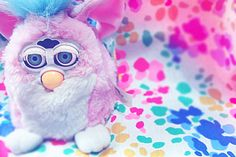 Furby Baby. i had this exact one and i swear it always waited until i was asleep to talk.