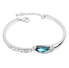 Blue Crystal Bangle Bracelet by Brittany Mack: http://www.outbid.com/auctions/15188-night-owl-s-marketplace-5-13-13#75