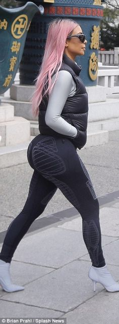 Wow: The entrepreneur, 37, flaunted her pert derriere in the patterned spandex, adding a long sleeved shirt and a vest