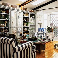 A shelving unit is the ultimate style fixer for a drab room, plus it's an easy way to add your own personality to a room.                                         Use it as a library, entertainment center, or place to showcase trinkets from traveling. Vary the height, shape, and texture                                         of the displayed objects for a loose feel.