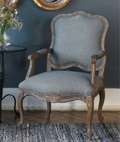 Pine and white mahogany frame with reinforced joinery, hand carved and hand finished in an ash gray wash over natural wood grain. Woven polyester in steel gray and tan with individually hammered nail accents. Seat height is 20