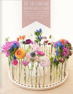 centro de mesa flores tubos de ensayo flutter